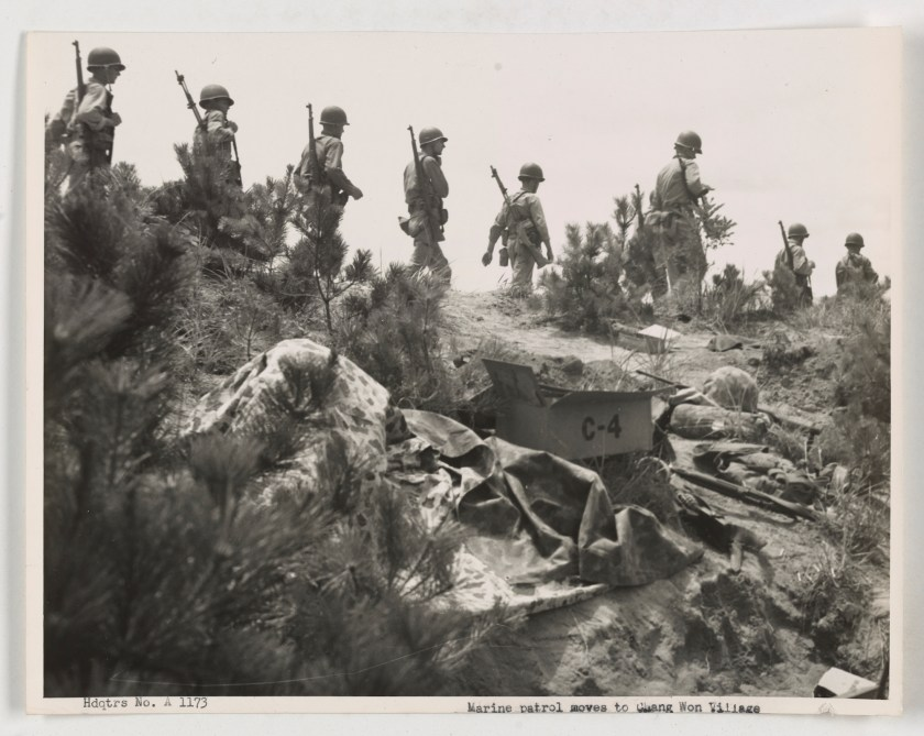 Korean War: Marine patrol near Chang Don village.