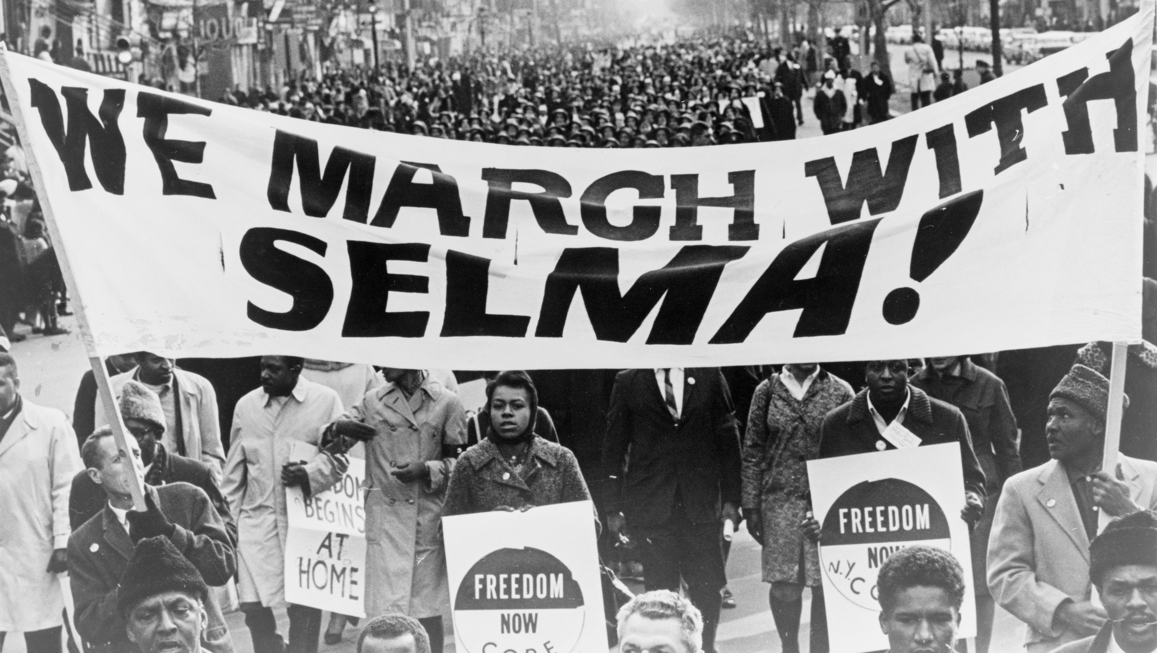 "Demonstrators carrying ""March with Selma"" banner"
