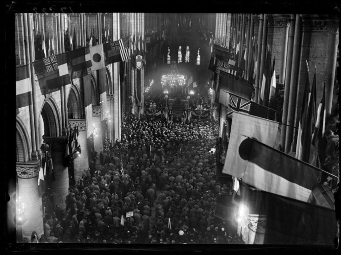 """1914-1918 War. The feast of the rescue of Alsace-Lorraine. Celebration of """"Te Deum"""", presided over by Cardinal Amette, in Notre-Dame Cathedral. """"The"""" Te Deum """"of the victory was not sung in France since Solferino"""". Paris, November 17, 1918. Photograph published in the newspaper """"Excelsior"""" of Monday, November 18, 1918."""