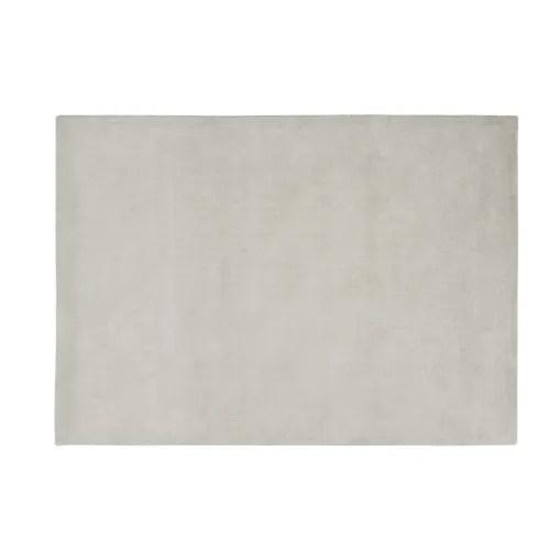 tapis a poils courts en laine gris 140 x 200 cm maisons du monde