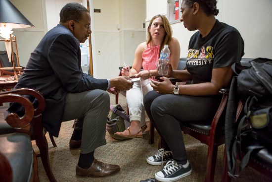 Morgan State University Professor Ron Taylor instructs MSU journalism student Maya Gilmore and WVU Reed College of Media student Kelsey Staggers in a story conference during the project in Selma. Photo by David Smith
