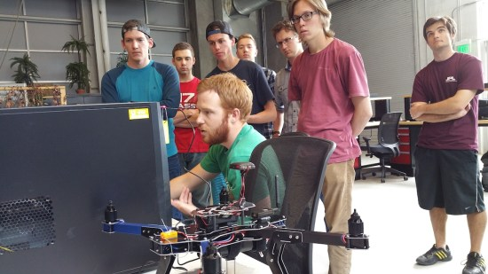 Students work to calibrate a drone before operating it in the DARC Lab.