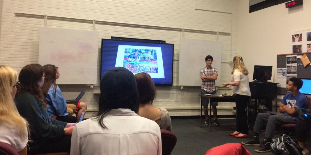 Media Hub students review a peer's multimedia presentation. Image Source: Jane Violette