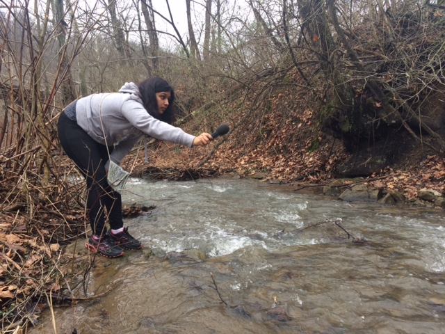 Photo by: Emily Hughes Corio West Virginia University Reed College of Media graduate student Shishira Sreenivas records ambient sounds for her reporting project as sensors were deployed in a stream to test conductivity levels and temperature.