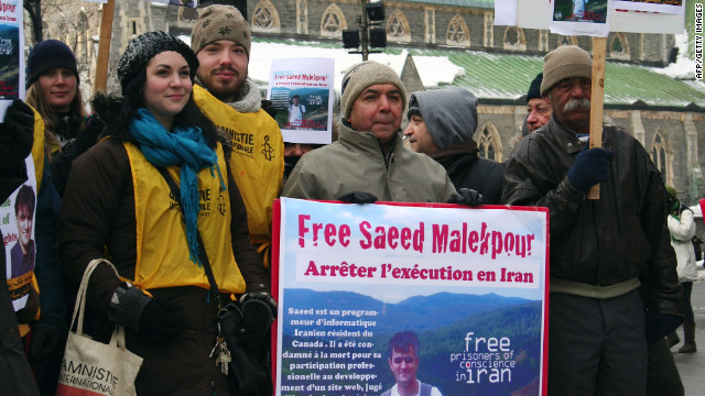 Individuals rally to free Saeed Malekpour. Photo by Robert Daly on Flickr, used under the Creative Commons license.