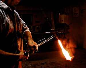 Metalsmith Rusty Griffin works on Captain Kendrick's sword for 'Hit and Run History.'