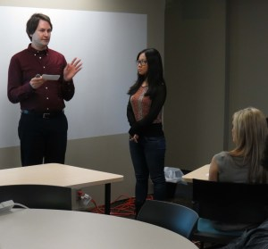 Student Tyler Stafford and Tiffany Zhou give their pitch for app Turn It Off. Photo by Michael Lander.