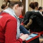 UW-Madison student Abby Becker tweets to the #socialj class hashtag on one of the course ipads loaned to students at the beginning of the semester.
