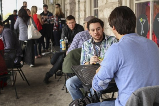SXSW attendees talk to each other during an event. Photo by the Flickr group Tech Cocktail and reused here with Creative Commons license.
