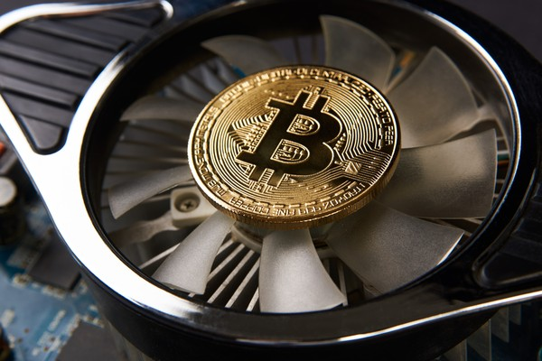 Computer fan with a gold bitcoin in the center.