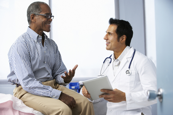 locum tenens doctor with patient