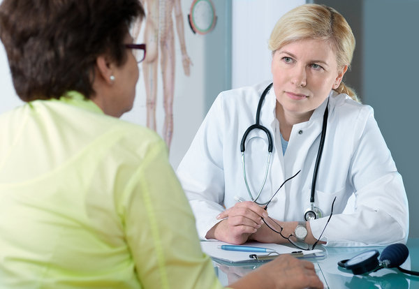 nurse practitioner consults with patient