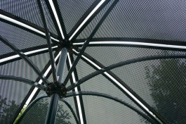 Stony Brook, NY - An abstract display of pattern by an umbrella outside Staller Center. By Joanna Tavares