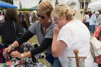 """Levittown, NY - Joan Costello helps a customer pick out a piece of custom made jewelry at the Country Craft Fair at Good Shephard Lutheran Church on Saturday, September 13, 2014. """"We try to see what people are shopping for,"""" Costello's assistant Erica Falcone, of Bethpage, NY, said. """"We try to help them put together an outfit."""""""