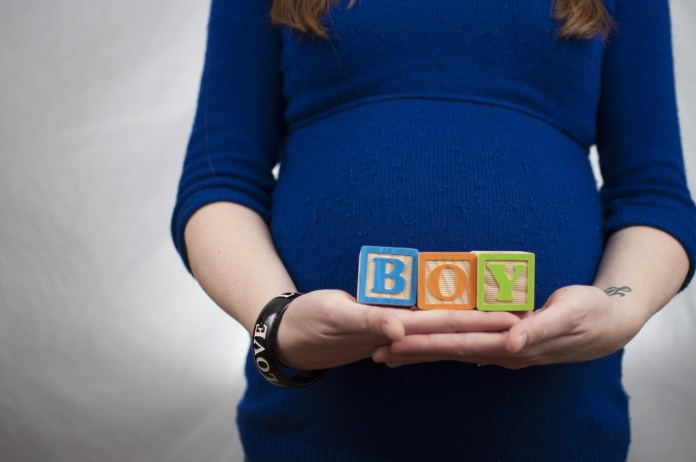 alphabet blocks hands mother pregnancy pregnant woman