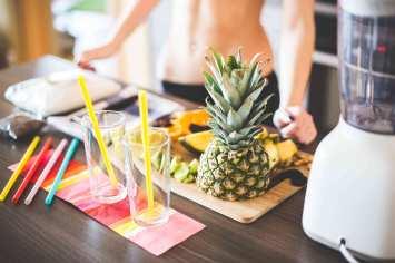 fitness-girl-preparing-healthy-fruit-milkshake-picjumbo-com1