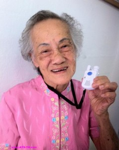 Senior Lady Holding Lightwieght Pendant