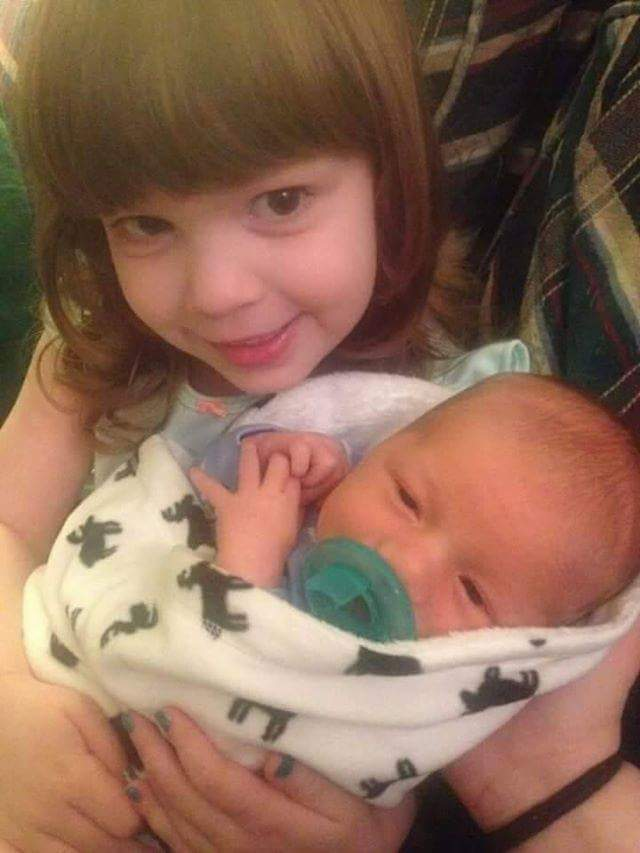 Holly Baylee holding baby brother