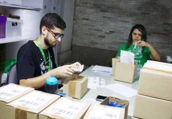 medical marijuana workers packing boxes in Brazil