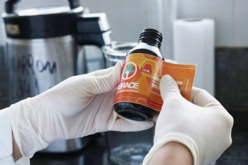 Medical marijuana oil being labelled in Brazilian lab