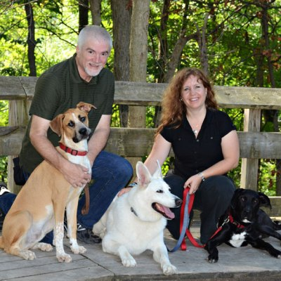 Owners of Medical Mutts Jennifer Cattet and Jack Topham with their dogs.