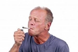 middle aged guy smoking weed