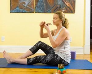 Woman-smoking-pot-and-doing-yoga