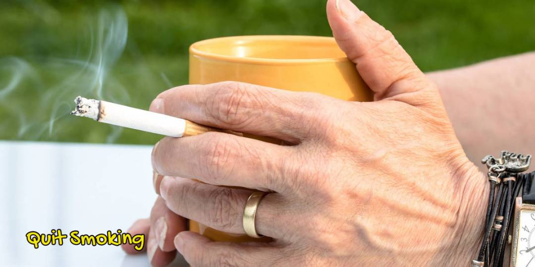 Image of a hand holding a cigarette to depict Quit Smoking when Turning 65