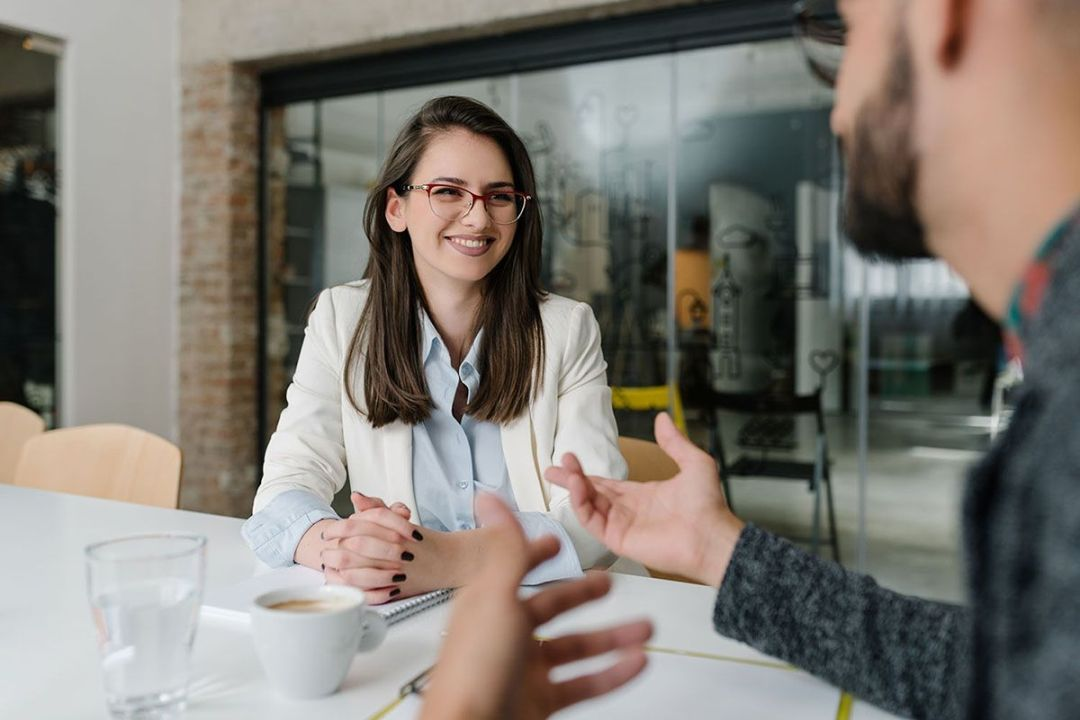 Girl smiling at a job interview