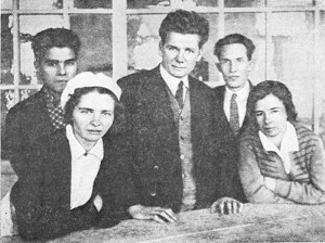A group portrait of three men and two women.