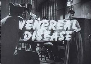 The words 'Venereal Disease' superimposed over a scene of soldiers and women in a night club.