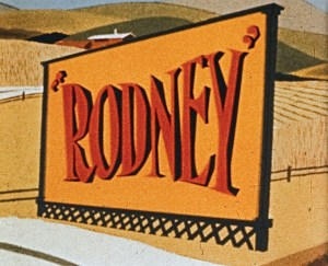The word Rodney on an outdoor billboard in farm country.