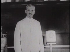 Film still of DeLee talking.