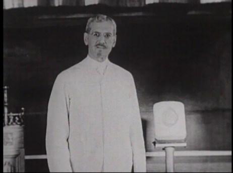 Film still of DeLee talking.