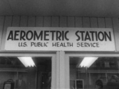 a sign on top of two windows that read : Areometric Station, U.S public health service