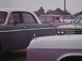 Close up of different colored old cars