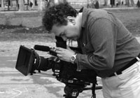 Photo of Michael Masucci operating a camera