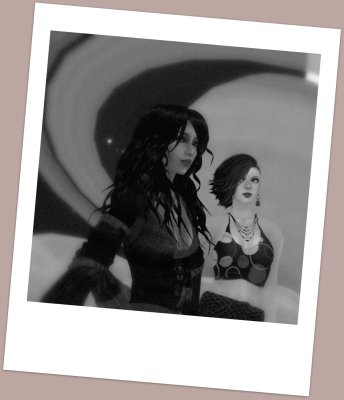 """selenium-toned polaroid photograph of Kimika Ying and Vanessa Blaylock at the LEA27 """"Oceania Planetary Park"""" sim in Second Life. Behind them the planet Saturn is rising."""