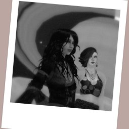 "selenium-toned polaroid photograph of Kimika Ying and Vanessa Blaylock at the LEA27 ""Oceania Planetary Park"" sim in Second Life. Behind them the planet Saturn is rising."