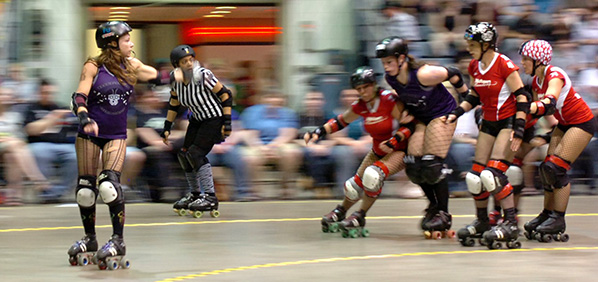 photo of roller derby skaters circling a track or riding tangent lines of the inner ring