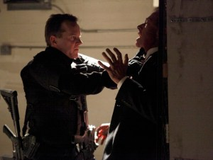 Photograph of Jack Bauer pushing a man up against a wall and strangling him