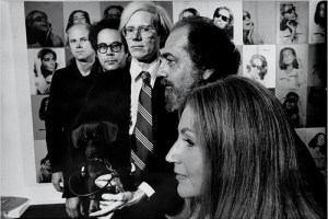 black-and-white photo of James Rosenquist, George Segal, Andy Warhol, Robert Scull & Ethel Scull in front of Andy Warhol's Ethel Scull 36 Times