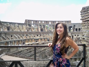 Medici University student with the Coliseum in Rome behind her