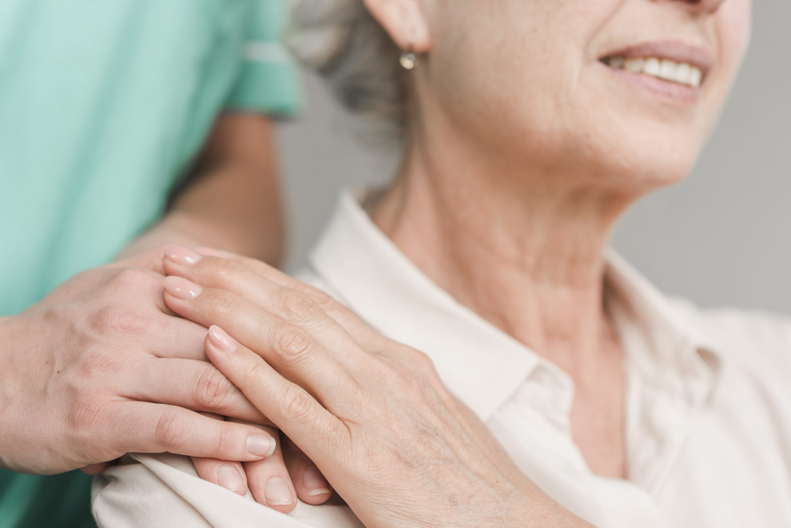 home health aide with hand on senior's shoulder