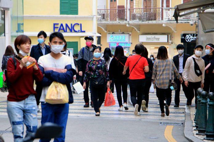 Crowd wearing masks