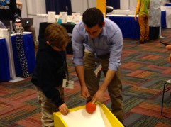 Jack Lieberman, 8, of Merrionette Park, learns about physics and gravity at the Fermi National Accelerator Lab booth.