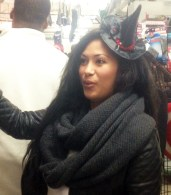 A female customer tries on an embellished mini top hat at the Halloween Store in Chicago.