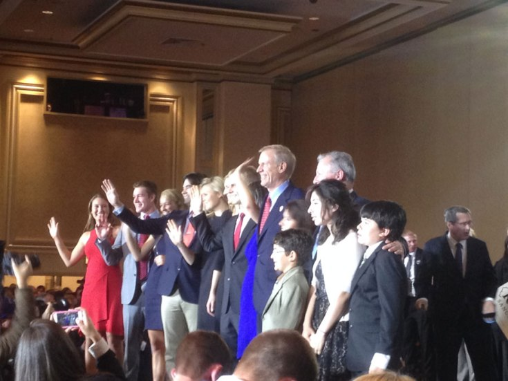 Rauner and his family wave farewell to supporters following his speech.