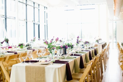 Seubold and Joyce hosted their reception at Greenhouse Loft, a sustainable event space. Flowers arranged by Pollen Floral Design. Photo by Cassandra Eldridge Photography.