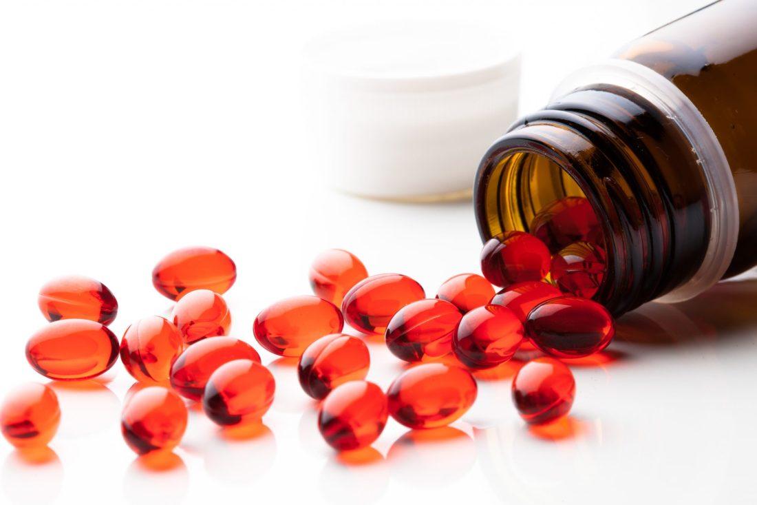 vitamin E capsules on white background